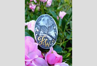 Engraving of a Weimaraner hunting dog on pistol grip cap. The owner's initials inlaid in gold