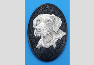 Pistol grip cap with engraving of a German Wirehaired Pointer in solid silver inlay based on a photo. Grip cap burnished.
