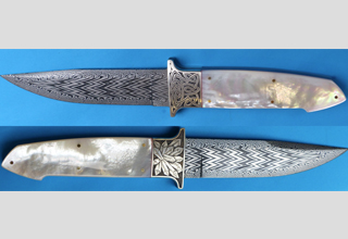 High quality damask knife with engraving of Celtic loops and a crystal formation
