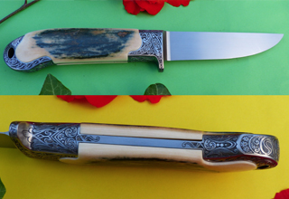 Integral knife engraved with a self-designed ornament.
