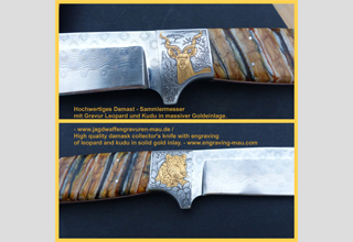 High quality damask collector's knife with engraving of leopard and kudu in solid gold inlay.